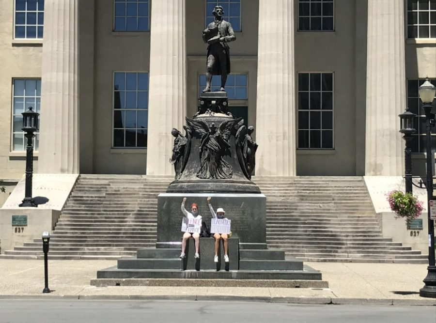 Mackenna Williams (12) and Sarah Burbank (12) protesting downtown.